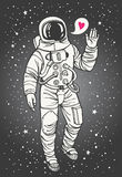 Cosmonaut with raised hand in salute and heart Royalty Free Stock Images