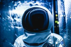 Cosmonaut in a space suit ready to go to space. Cosmonaut in a space suit inside space ship stock photos