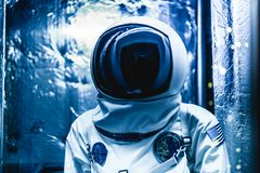 Cosmonaut in a space suit ready to go to space stock photo