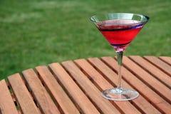 Cosmopolitan. Delicious beverage placed outside atop a picnic table stock photos