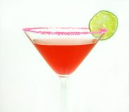 Cosmopolitan. Cosmo cocktail with lime and pink sugar on isolated background Stock Image