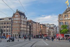 The cosmopolitan Amsterdam. AMSTERDAM, NETHERLANDS – JUNE 22, 2016: A view of buildings along one of the populous streets of Amsterdam, Netherlands on June 22 Royalty Free Stock Photos