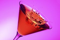 Cosmopolitan cocktail. Sophisticated cosmopolitan cocktail with splash Royalty Free Stock Photo