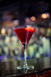 Cosmopolitan cocktail on the bar. Cosmopolitan classy cocktail on the bar Royalty Free Stock Photography