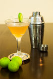 Cosmopolitan cocktail with Cocktail shaker and lime Royalty Free Stock Photos