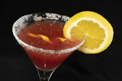 Cosmopolitan Cocktail with cranberry juice, vodka, lime juice and cointreau. With isolated black background stock images