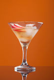Cosmopolitan cocktail drink. On yellow background stock photography