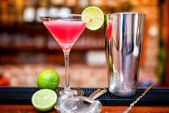 Cosmopolitan cocktail drink at casino and bar served with lime Stock Photography