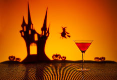 Cosmopolitan cocktail in Halloween setting. Halloween haunted house witch and a Cosmopolitan cocktail Royalty Free Stock Images