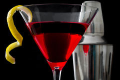 Cosmopolitan cocktail and shaker on black background Stock Photography