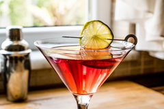 Cosmopolitan Cocktail with shaker on wooden surface. Beverage Concept royalty free stock image