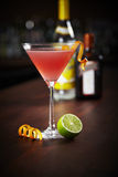 Cosmopolitan coctail. Cosmopolitan in a martini glass with lime Stock Photo