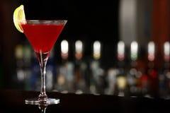 Cosmopolitan drink. Over black bar royalty free stock photos