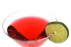 Cosmopolitan Drink Isolated. Red Cosmopolitan with lime slice isolated on white background stock photography