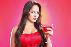 Cosmopolitan girl. Cute brunette handling her martini cocktail Royalty Free Stock Photo