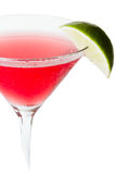 Cosmopolitan. Isolated cosmopolitan on a white background garnished with a lime Royalty Free Stock Image