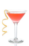 Cosmopolitan martini cocktail with vodka red cranberry juice. Lime and lemon spiral isolated on a white background Stock Image