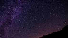 Cosmos. Perseid- meteorite on the Milky Way and starry sky Stock Images