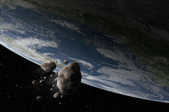 Cosmos scene with asteroid and planet Earth Royalty Free Stock Photos