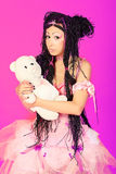 Cosplay. Beautiful cosplay young woman in a doll costume Stock Images