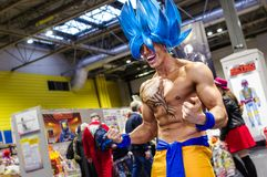 Cosplay as character from Dragon Ball. Birmingham, UK - November 18, 2017: Cosplayer dressed as Goku in his Supersaiyen Blue form from Dragon Ball at Birmingham Royalty Free Stock Photography