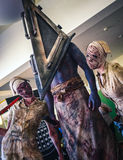Cosplay as `Silent Hill` characters. Scarborough, UK - April 09, 2017: Cosplayers dressed as `Pyramid Head` and nurses from the video game series and film Silent Stock Photo