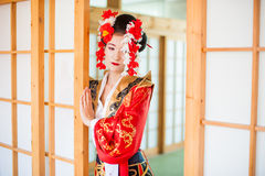 Cosplay. beautiful, modest geisha in a red kimono Stock Photography