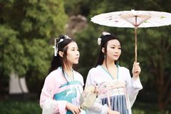 Cosplay Chinese best close friends bestie in traditional ancient drama costume hanfu. Chinese beauty in traditional ancient costume, hold a fan on hand, elegant royalty free stock photos
