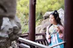 Cosplay Chinese classic beauty in traditional ancient drama costume hanfu. Chinese beauty in traditional ancient costume, hold a fan on hand, elegant people stock photography