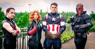 Cosplay como caracteres de la maravilla y de los tebeos de DC Fotografía de archivo libre de regalías