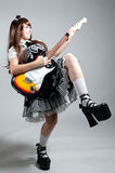 Cosplay girl in black dress with guitar Stock Photo