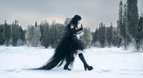 Cosplay girl in black uniform. Walking Royalty Free Stock Image