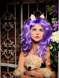 Cosplay girl in purple wig with soft toy Stock Photo