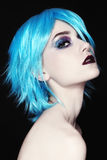 Cosplay. Portrait of young beautiful girl in fancy blue wig Stock Photo