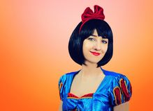 Cosplay of Snow White on the pink-orange background. Artistic processing.  royalty free stock image