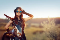 Cosplay Steampunk Woman Next to Her Motorcycle Stock Photos