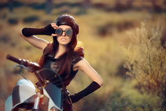 Cosplay Steampunk Woman Next to Her Motorcycle Royalty Free Stock Image