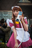 Maid cosplay in Tokyo. Tokyo, Japan - December 30, 2014: Cosplayer dressed as a maid at Comiket.  Comiket is the world's largest 'dojinshi' &#x28 Royalty Free Stock Images