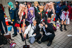 Cosplay in Tokyo. Tokyo, Japan - December 30, 2014:   Cosplayers dressed as characters from the video game 'Danganronpa'.  Comiket is the world's largest ' Stock Photo