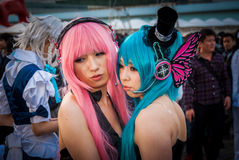 Cosplay in Tokyo. Tokyo, Japan - December 30, 2014: Cosplayers dressed as 'Vocaloids' at Comiket.  Comiket is the world's largest 'dojinshi' (fan made self Royalty Free Stock Images
