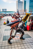 Monster Hunter cosplay in Tokyo. Tokyo, Japan - December 30, 2014: Cosplayer dressed in 'Rathalos Armour' from video game 'Monster Hunter' at Stock Image