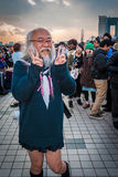 Cosplay in Tokyo. Tokyo, Japan - December 30, 2014: Old man dressed as a schoolgirl at Comiket.  Comiket is the world's largest 'dojinshi' &#x28 Stock Photography