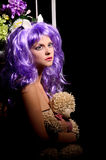 Cosplay young woman in purple wig with toy Royalty Free Stock Images