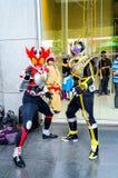 Cosplayer als Charaktere Kamen Rider Lizenzfreie Stockfotos