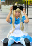 "Cosplayer as characters Alice from Walt Disney ""Alice in Wonderland Stock Images"