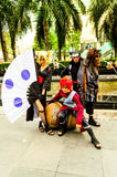 Cosplayer as characters Gaara, Kankuro and Temari from Naruto. Stock Photos
