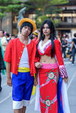 Cosplayer as characters Monkey D. Luffy and Boa Hancock from One Piece Stock Photography