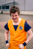 Cosplayer dressed as `Goku` from `Dragonball Z`. Sheffield, UK - June 12, 2016:   Cosplayer dressed as `Goku` from `Dragonball Z` at the Yorkshire Cosplay Stock Photo