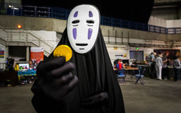 Cosplayer dressed as `No Face` from `Spirited Away` Stock Photos