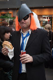 Cosplayer eating a sandwich at Festival del Fumetto convention in Milan, Italy Royalty Free Stock Photography